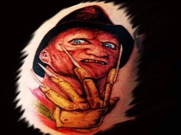 Colored Freddy Krueger Tattoo with Blue Eyes and Gold Glove