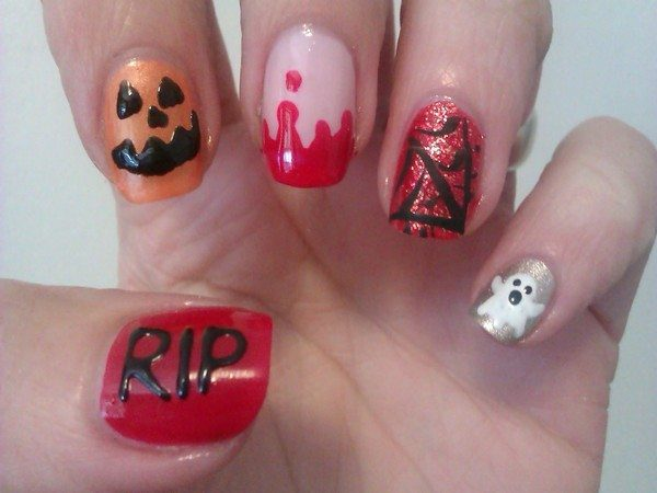 One Orange Pumpkin Nail, One Bloody Tipped Nail, One Red Nail with Spider Web, One Red Nail with RIP, and One Silver Nail with Ghost