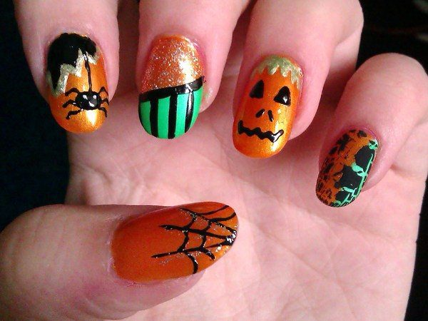 Orange Nails with Black Spider Webs, Spiders, a Pumpkin Face, and Black and Green Stripes