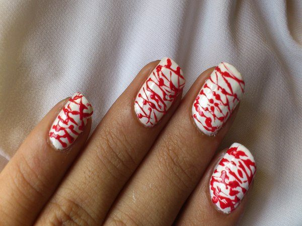 White Nails with Blood Splatters