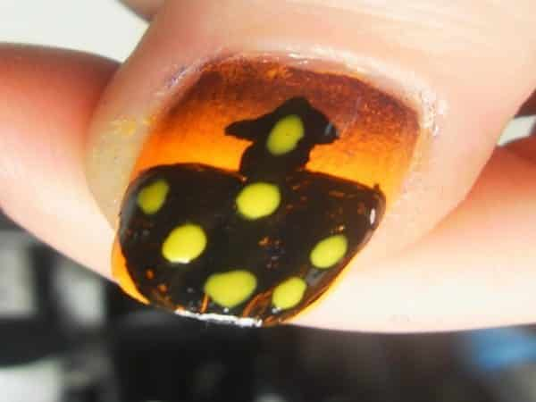 Orange Nail with Black House and Glowing Lights