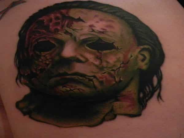 Colored Michael Myers Tattoo with Green Skin and Ripped Mask
