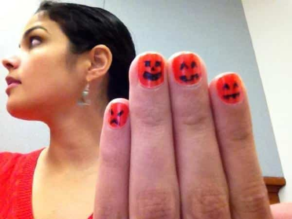 Orange Nails with Black Faces