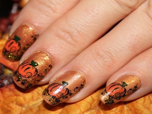Gold Nails with Pumpkins and Swirling Designs