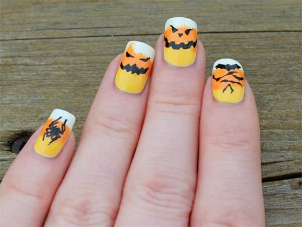 Candy Corn Nails with a Spider, a Bat, and Pumpkin Faces