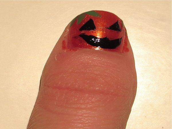 Orange Glitter Nail with Carved Pumpkin Face and Stem