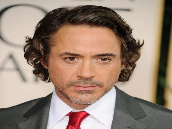 Robert Downey With Grown Out Curly Hair Parted To The Side