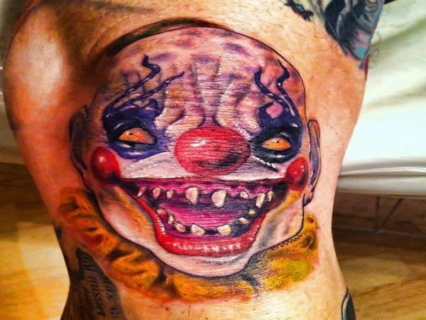Wide Grinning Colored Scary Clown Tattoo