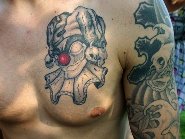 Black Ink Jester with Red Nose Clown Tattoo