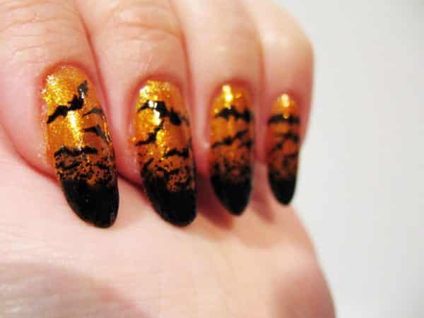 Orange Glitter Nails with Black Tips Turning into Bats