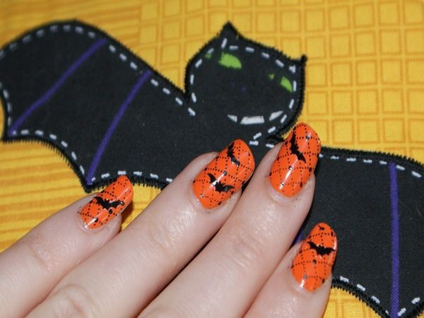 Orange Nails with Black Bats and Black Dots