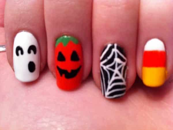 One White Ghost Nail, One Pumpkin Nail, One Black Spider Web Nail, and One Candy Corn Nail