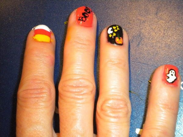 Orange Boo Nails, Black Pumpkin Nails, Candy Corn Nail, and One Orange Nail with White Ghost