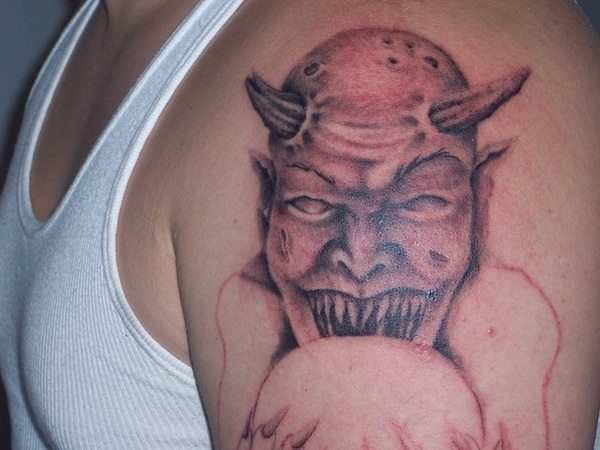 Bald Devil Tattoo with Pointy Teeth
