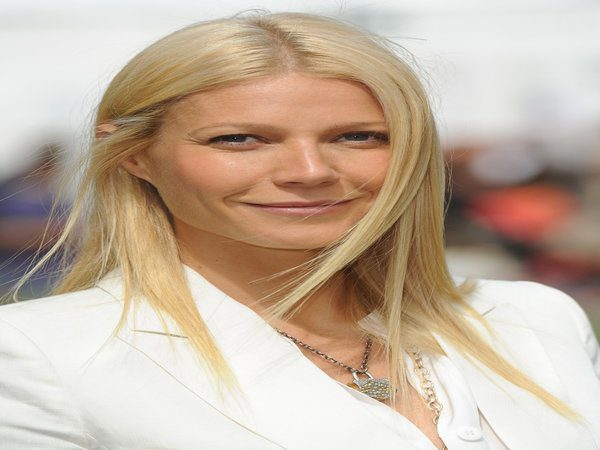 Gwyneth Paltrow with Golden Blond Straight Long Hair Parted In the Middle