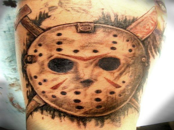 Jason Voorhees Mask Tattoo with Crossed Weapons