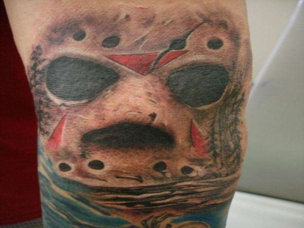Jason Voorhees Mask Leg Tattoo with Blue Colored Background