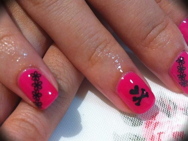 Robust Pink Nails with Heart Skull and Crossbones and Flowers