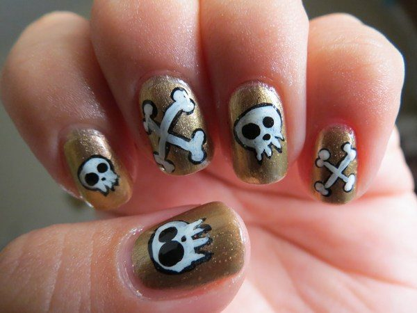 Gold Nails with Skull and Crossbones