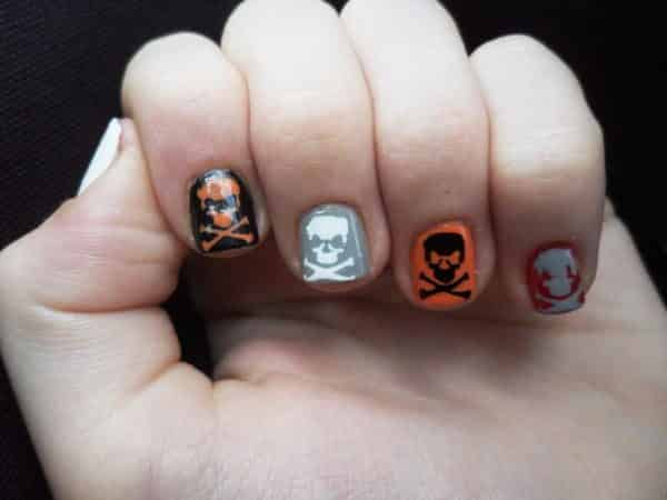 Black, Orange, Silver, and Red Nails with Skull and Crossbones