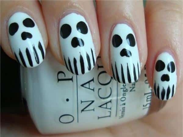 White Nails with Black Skull Nails