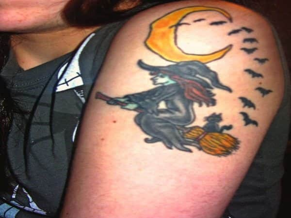 Colored Witch with Red Hair Tattoo, Riding a Broomstick with Bats and Yellow Moon
