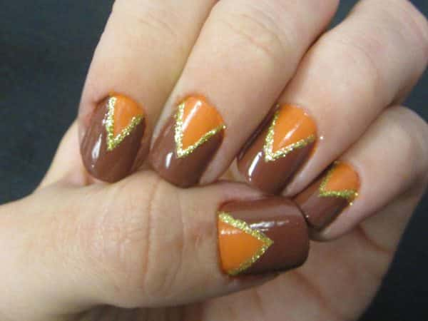 Brown and Orange Nails with Triangle Designs Outlined in Gold