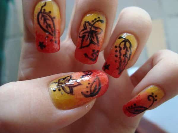 Orange, Yellow, and Red Nails with Brown Leaves
