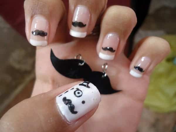 French Manicured Nails with Mustaches and One White Nail with a Face and Hat
