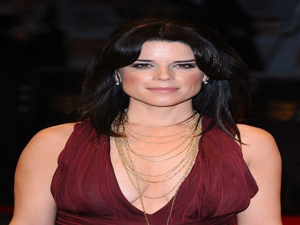 Neve Campbell Shoulder Length Hair with Curly Parted Bangs