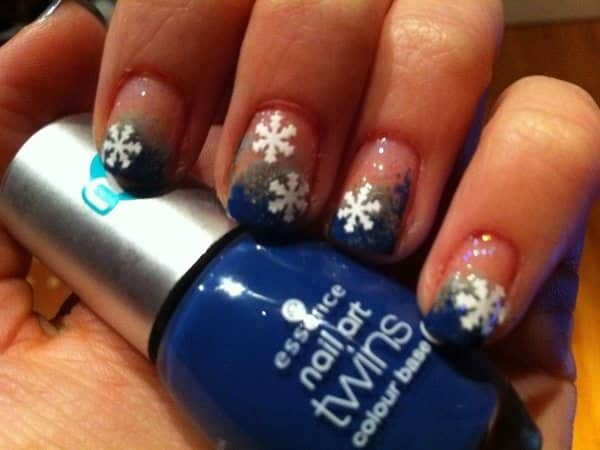 Plain Nails with Blue Glitter Tips and White Snowflakes