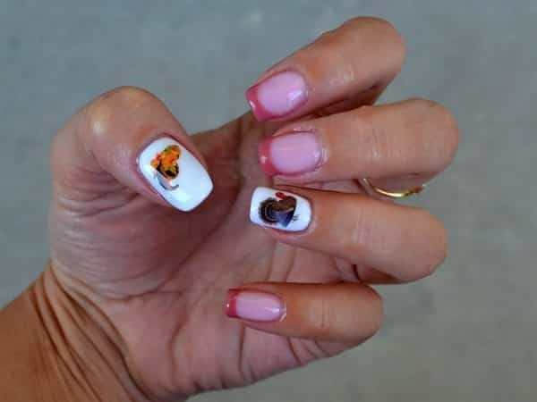 Plain Red Tipped Nails with Two White Nails with Thanksgiving Designs