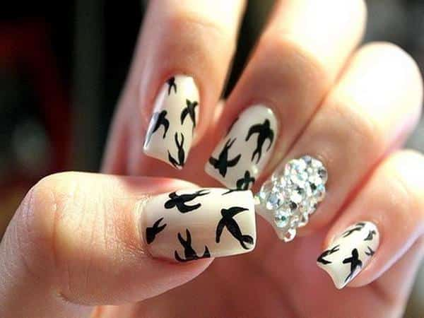 White Nails with Black Birds and a Single Rhinestone Nail