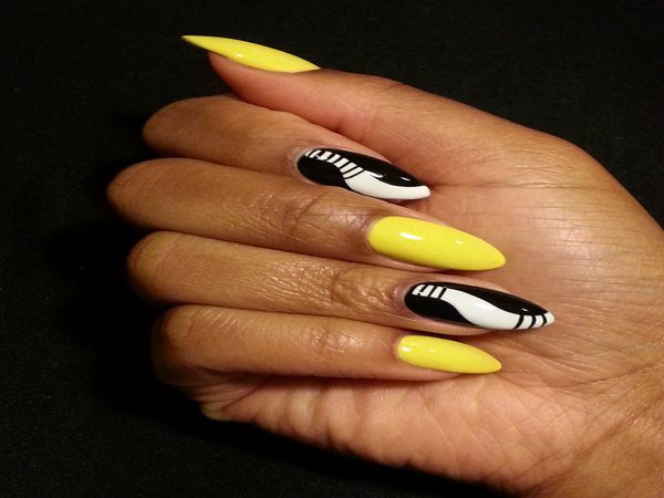Yellow and Black Nails with White Swirling Line