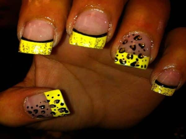 Plain Nails with Two Black Cheetah Designs and Black Lined Yellow Tips