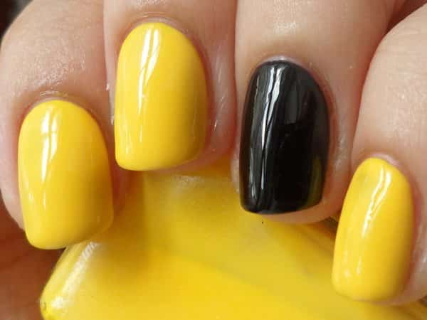 Yellow Nail and One Black Nail