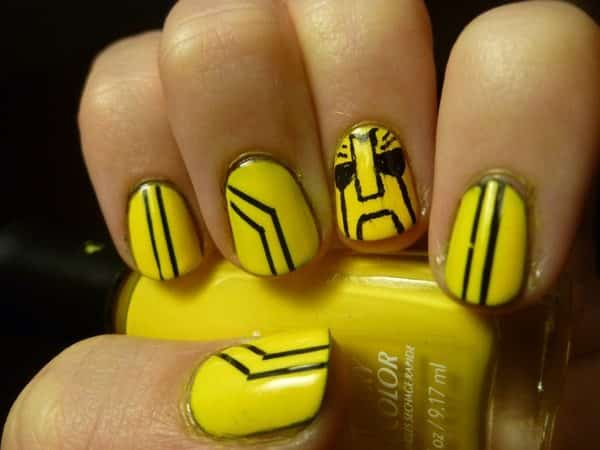 Yellow Nails with Black Car Strip Design and One Face Nail