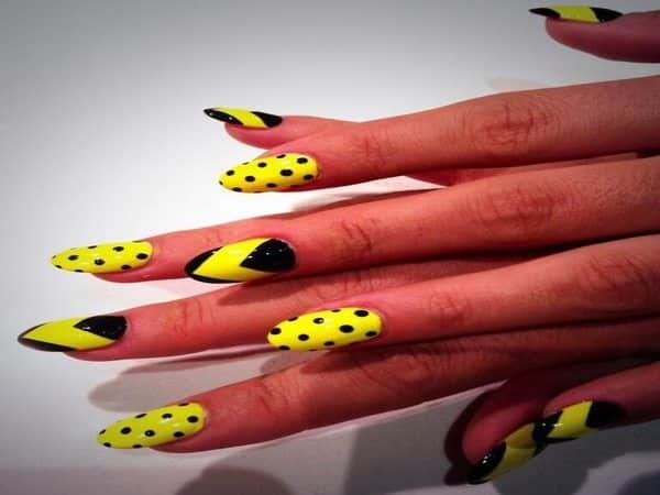Yellow and Black Nails with Polka Dots and Chevron Shapes