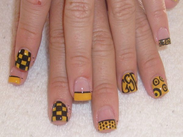 Plain Nails with Yellow and Black Designs Including Checkers, Spots, and Letters