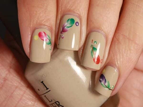 Beige Nails with Tiny Rainbow Feathers
