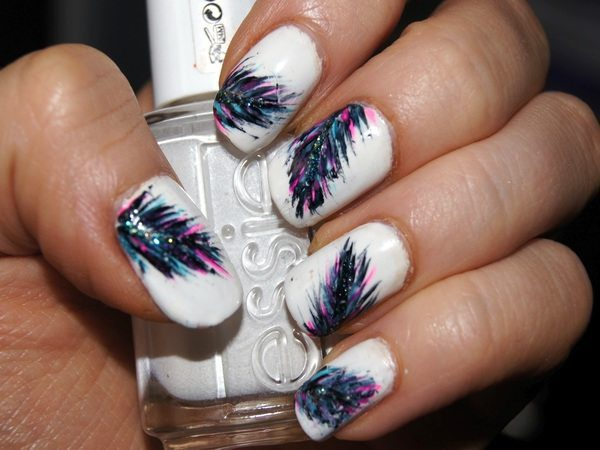 White Nails wih Colorful Glitter Feather Designs