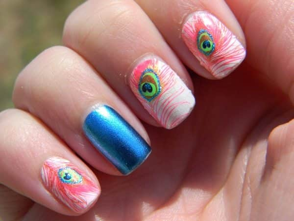 White Nails with Pink Peacock Feathers and One Blue Nail
