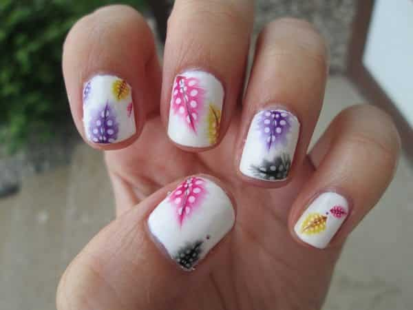 White Nails with Pink, Black, and Yellow Feathers