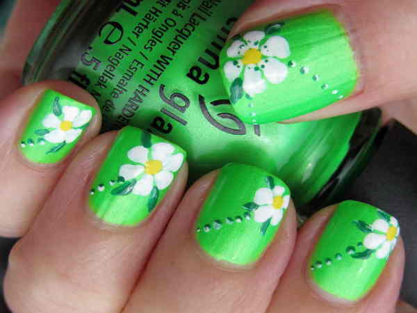 Green Nails with White Flowers with Yellow Centers and Dots