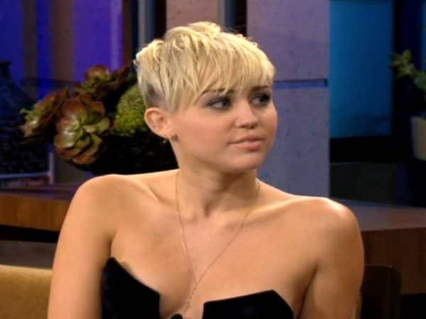 Miley Cyrus with Platinum Blond Hair with Long Bangs