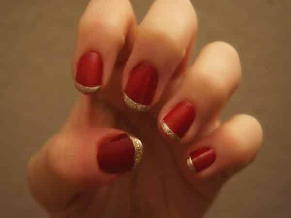 Red Nails with Gold Glitter Tips