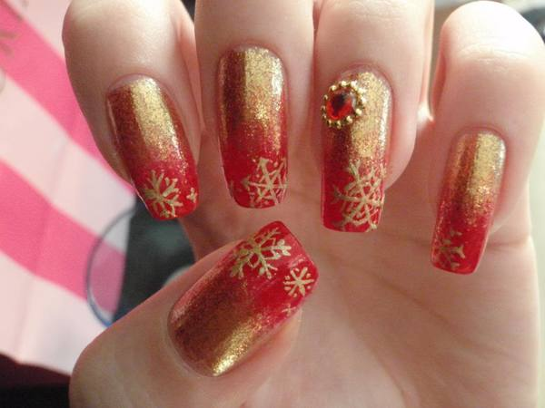 Long Half Red Half Gold Nails with Gold Snowflakes and a Red Rhinestone - 11 Beautiful Red And Gold Nail Designs