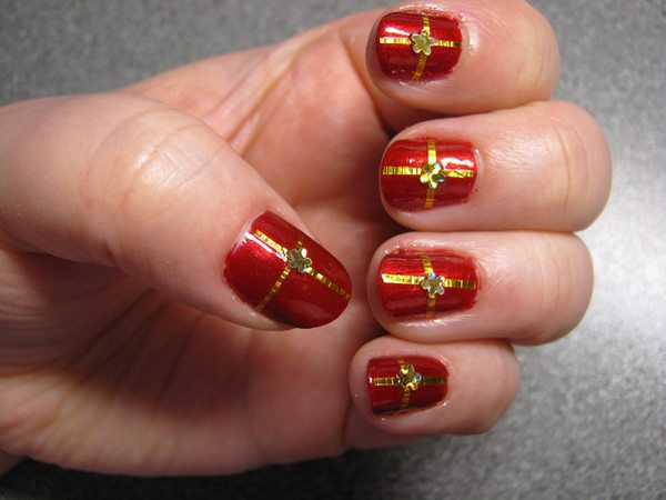 Red Nails with Gold Ribbon and Gold Flowers