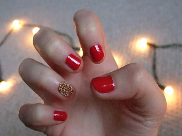Shiny Red Nails with Single Gold Dotted Nail