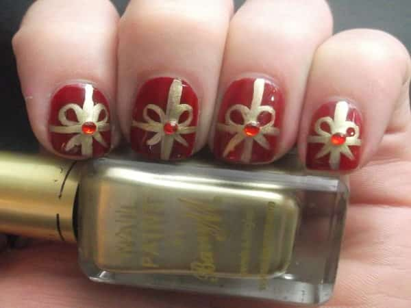 Short Red Nails with Gold Bows and Red Rhinestones